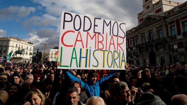 A Podemos party supporter holds a placard reading 'We can change the history' at the end of a march on January 31, 2015 in Madrid, Spain